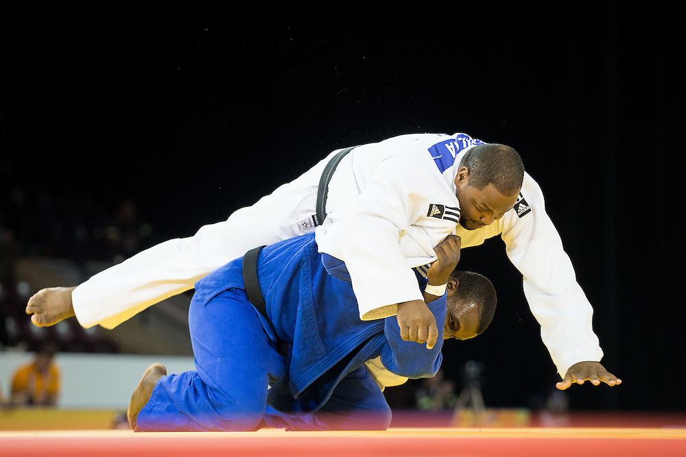 Alex Garcia (Top) of Cuba tries to avoid being thrown by  Ramon Pileta of Honduras during the bronze medal contest in the mens judo +100kg class at the 2015 Pan American Games in Toronto, Canada, July 14,  2015.  AFP PHOTO/GEOFF ROBINS