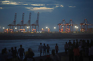 People crowd Galle Face Green as the cranes of port are seen in the background in Colombo, Sri Lanka on July 19, 2015.<br /> (Photo by Kuni Takahashi)