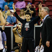 09 March 2018: San Diego State men's basketball takes on Nevada in the quarterfinal round of the Mountain West Conference Tournament. San Diego State Aztecs guard Jordan Schakel (20) throws up threes as the Aztecs make a three pointer in the first half. The Aztecs cruise past the Wolfpack 90-73 to move on to the Championship game tomorrow afternoon at 3pm.<br /> More game action at www.sdsuaztecphotos.com