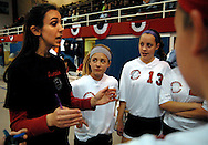10 DEC. 2010 -- ST. LOUIS -- Volleyball players from Assumption School gather around their coach during a break in the action during their game with Holy Infant School during the championship match of the CYC girls' parochial closed division tournament at the Monsignor Meyer Youth Center in St. Louis Friday Dec. 10, 2010.  Image © copyright 2010 Sid Hastings.
