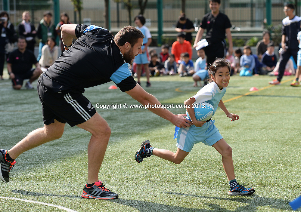 Jeremy Thrush plays tag during a visit to Aoyama Elementary School ahead of the test match tomorrow between the New Zealand All Blacks and Japan. Rugby Union. Tokyo, Japan. Friday 1 November 2013. Photo: Andrew Cornaga/www.Photosport.co.nz