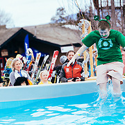 Participants jump into freezing cold water to raise awareness and money for the Wyoming division of the Special Olmpics at Jackson Hole Mountain Resort in Teton Village.
