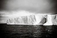 Huge iceberg on the ocean, black and white, Gerlache Strait, Antarctica. Landscape and nature photography wall art, fine art photography prints