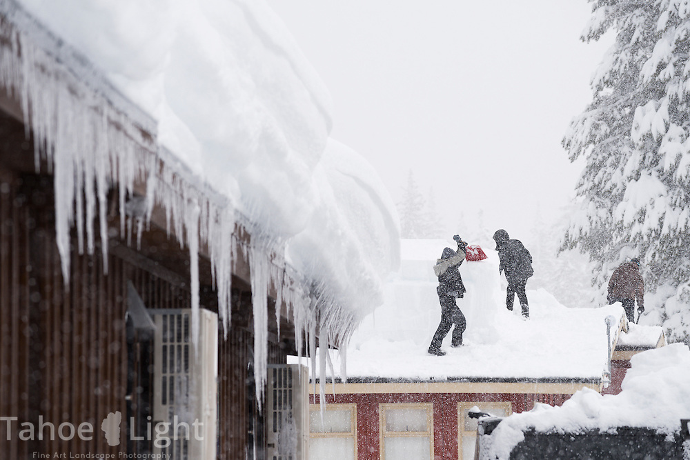 Workers remove massive snow piles from the roof of Squaw Valley buildings during the snowstorms of January, 2017, which saw some of the largest snow deposits in Lake Tahoe area history.