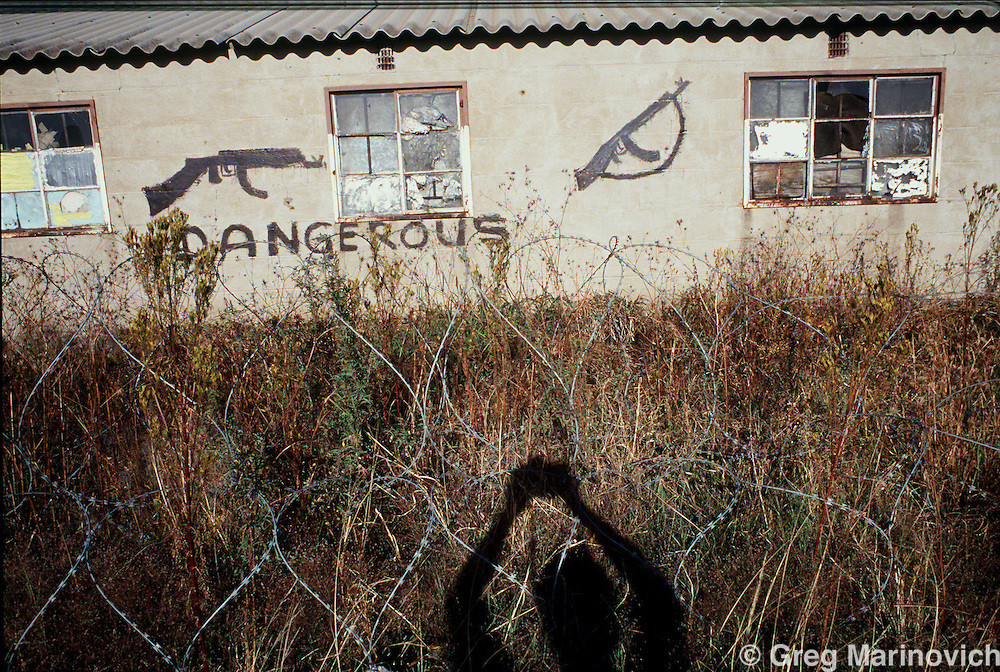 IPMG0042 South Africa, Thokoza, 1993..A migrant workers hostel in Thokoza, 1993.  Inkatha Freedom Party hostel residents controlled the hostels around Johannesburg. Thousands of people, both civilians and combatants died in the so-called Hostel War from 1989-1995..Photograph by Greg Marinovich/South Photographs