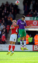 Bristol City's Derrick Williams battles for the high ball with Walsall's Tom Bradshaw  - Photo mandatory by-line: Joe Meredith/JMP - Mobile: 07966 386802 - 04/10/2014 - SPORT - Football - Walsall - Bescot Stadium - Walsall v Bristol City - Sky Bet League One