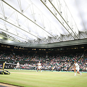 LONDON, ENGLAND - JULY 15:  Lucasz Kubot of Poland and Brazil's Marcelo Melo in action against Mate Pavic of Croatian and Oliver Marach of Austria in the Men's Doubles Final on Center Court with it's roof closed during the Wimbledon Lawn Tennis Championships at the All England Lawn Tennis and Croquet Club at Wimbledon on July 15, 2017 in London, England. (Photo by Tim Clayton/Corbis via Getty Images)