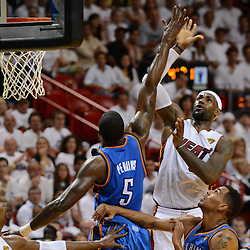 Jun 17, 2012; Miam, FL, USA; Miami Heat small forward LeBron James (6) shoots against Oklahoma City Thunder center Kendrick Perkins (5) during the second half in game three in the 2012 NBA Finals at the American Airlines Arena. Miami won 91-85. Mandatory Credit: Derick E. Hingle-US PRESSWIRE