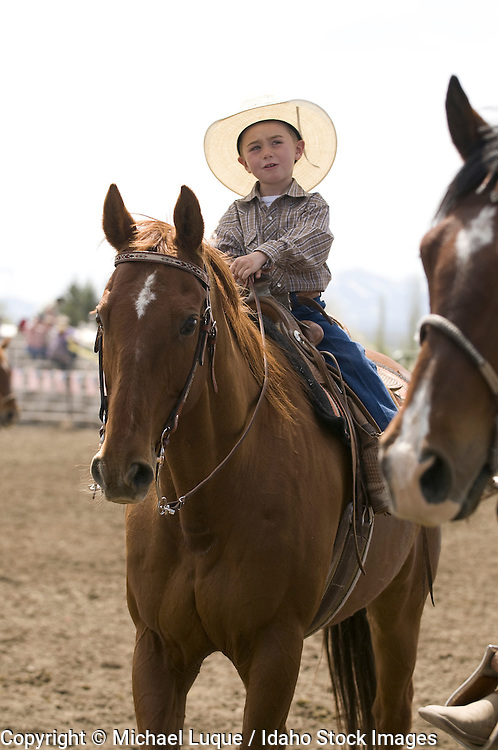 A young child shows horsemanship skills during a rodeo.