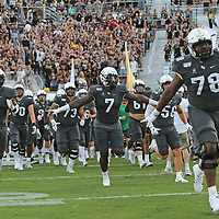 ORLANDO, FL - AUGUST 29: James Collins #78, Jaylon Robinson #7 and Raymond Cutts #2 of the UCF Knights run onto the field prior to a NCAA football game between the Florida A&M Rattlers and the UCF Knights on August 29 2019 in Orlando, Florida. (Photo by Alex Menendez/Getty Images) *** Local Caption *** James Collins;  Jaylon Robinson; Raymond Cutts