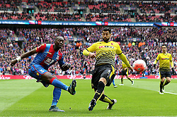 Yannick Bolasie of Crystal Palace crosses the ball past Miguel Angel Britos of Watford - Mandatory by-line: Robbie Stephenson/JMP - 24/04/2016 - FOOTBALL - Wembley Stadium - London, England - Crystal Palace v Watford - The Emirates FA Cup Semi-Final