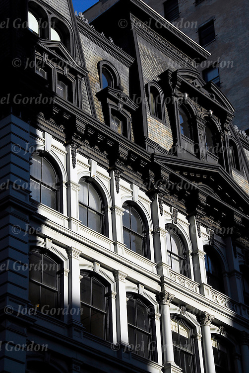 Play of light and shadows on architectural details on cast flat iron building on lower 5th Avenue in New York City.