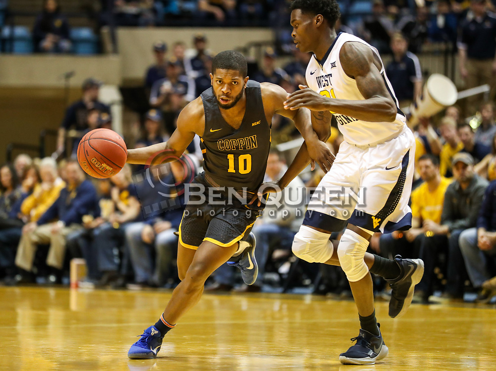 Dec 20, 2017; Morgantown, WV, USA; Coppin State Eagles guard Karonn Davis (10) dribbles the ball and is guarded by West Virginia Mountaineers forward Wesley Harris (21) during the first quarter at WVU Coliseum. Mandatory Credit: Ben Queen-USA TODAY Sports