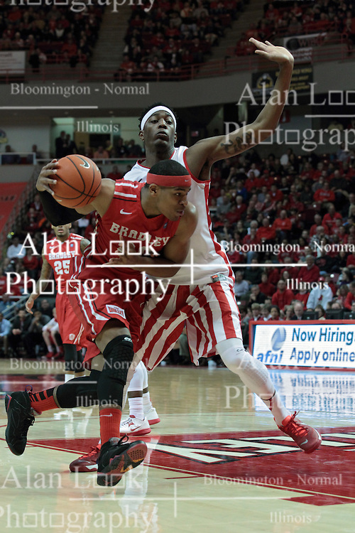 15 February 2014:  Tyshon Pickett looks to move the ball towards the hoop defended by Jamaal Samuel during an NCAA Missouri Valley Conference (MVC) mens basketball game between the Bradley Braves and the Illinois State Redbirds  in Redbird Arena, Normal IL.