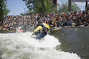 World Champion kayaker and boat maker Eric Jackson demonstrates some moves during the reno river festival
