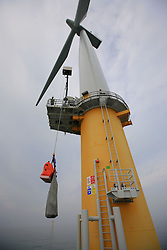 UK ENGLAND NORFOLK SHERINGHAM SHOAL 25SEP13 - Tidal Transit vessel crew transfer a load onto a wind turbine at the Sheringham Shoal wind farm in the North Sea off the Norfolk coast, England.<br /> <br /> <br /> <br /> jre/Photo by Jiri Rezac<br /> <br /> <br /> <br /> © Jiri Rezac 2013