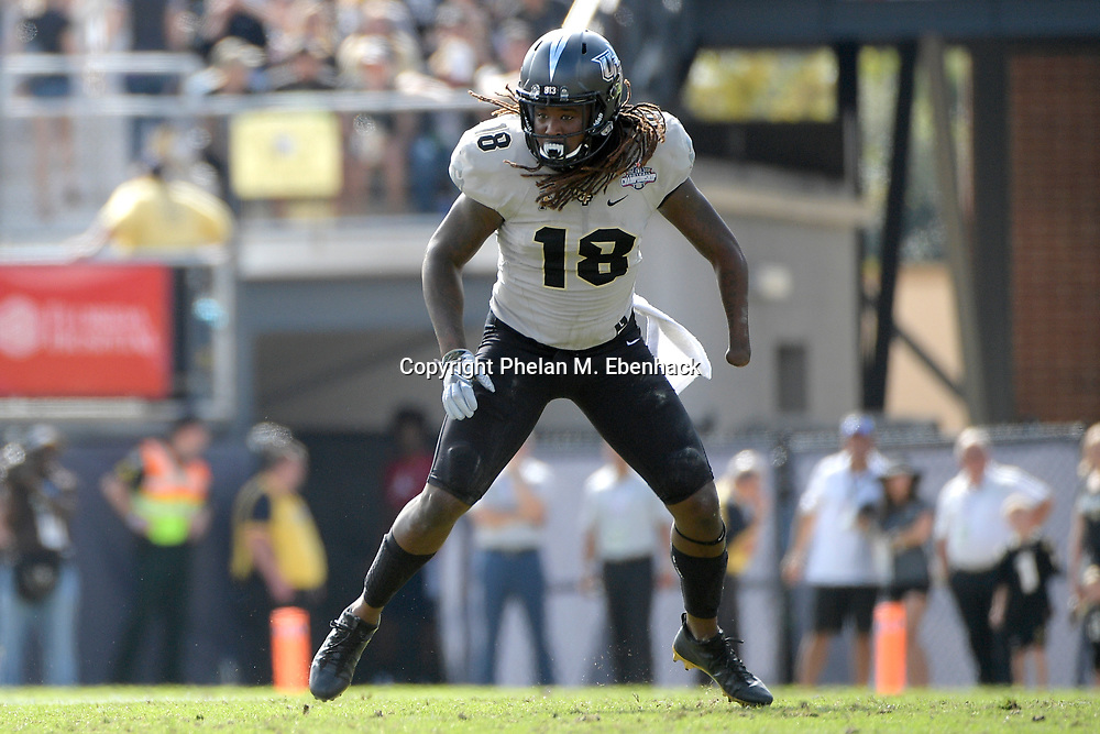 Central Florida linebacker Shaquem Griffin (18) follows a play during the first half of the American Athletic Conference championship NCAA college football game against Memphis Saturday, Dec. 2, 2017, in Orlando, Fla. (Photo by Phelan M. Ebenhack)