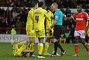 Alan Dunne is fouled during the Sky Bet Championship match between Nottingham Forest and Millwall at the City Ground, Nottingham, England on 31 January 2015. Photo by Jodie Minter.