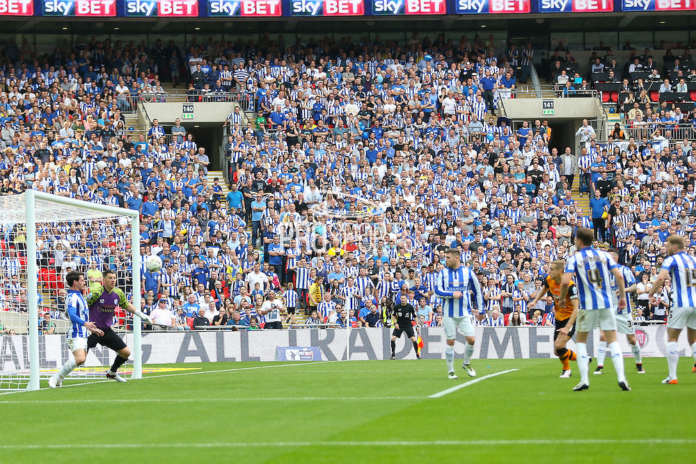 Hull City defender Michael Dawson (21) shoots at goal during the Sky Bet Championship Play-Off Final between Hull City and Sheffield Wednesday at Wembley Stadium, London, England on 28 May 2016. Photo by Phil Duncan.