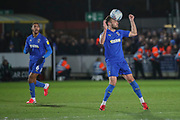 AFC Wimbledon defender Luke O'Neill (2) heading the ball during the EFL Sky Bet League 1 match between AFC Wimbledon and Ipswich Town at the Cherry Red Records Stadium, Kingston, England on 11 February 2020.