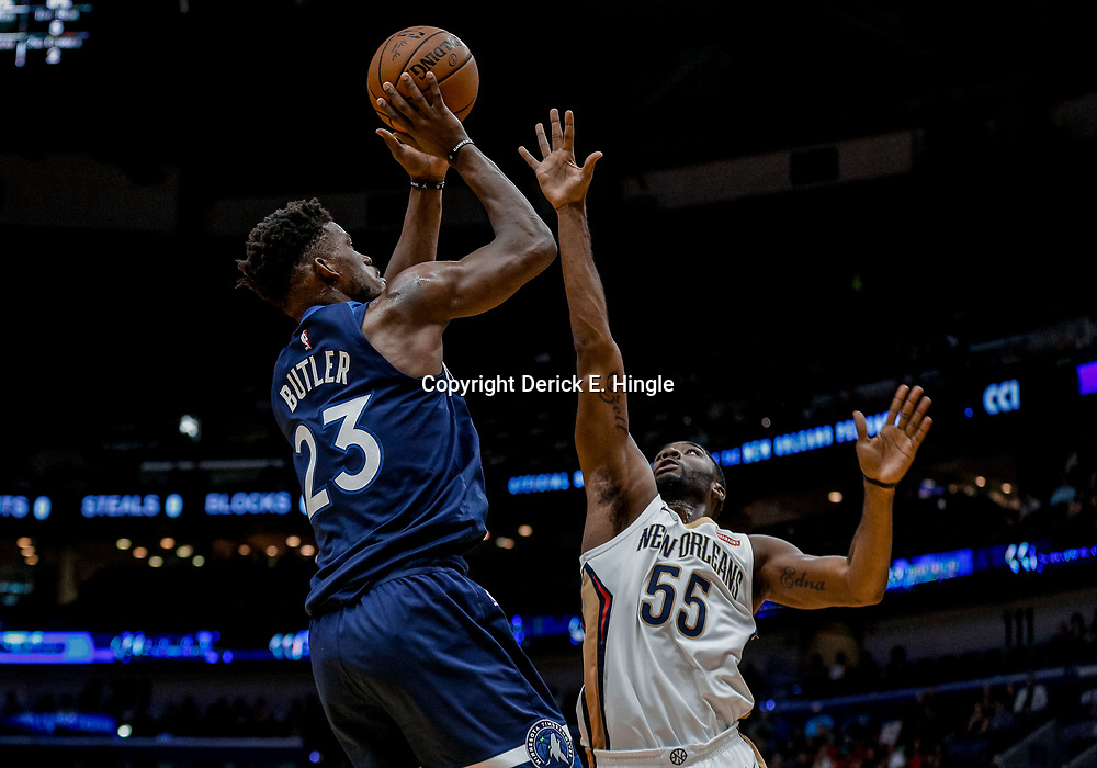 Nov 1, 2017; New Orleans, LA, USA; Minnesota Timberwolves guard Jimmy Butler (23) shoots over New Orleans Pelicans guard E'Twaun Moore (55) during the first quarter of a game at the Smoothie King Center. Mandatory Credit: Derick E. Hingle-USA TODAY Sports