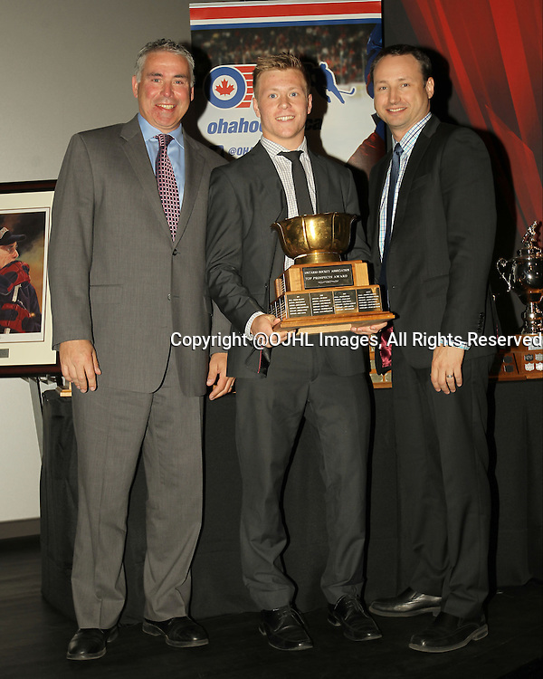 TORONTO, ON - Jun 5, 2015 : Ontario Hockey Association 2014-2015 Awards from the Hockey Hall of Fame in Toronto, Ontario Canada. Scott Farley Chief Executive Officer of the Ontario Hockey Association and Marty Savoy Commissioner of the Ontario Junior Hockey League present the  Top Prospect Award based on the National Hockey League Draft List, Defenceman Derek Topatigh of the Orangeville Flyers Hockey Club.<br /> (Photo by Tim Bates / OJHL Images)