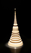 Ivory stupa model, 1800s, Thailand, carved ivory.  A stupa is a mound-like structure containing Buddhist relics.  Models of stupa are sold at Buddhist sanctuaries to be taken home by pilgrims.