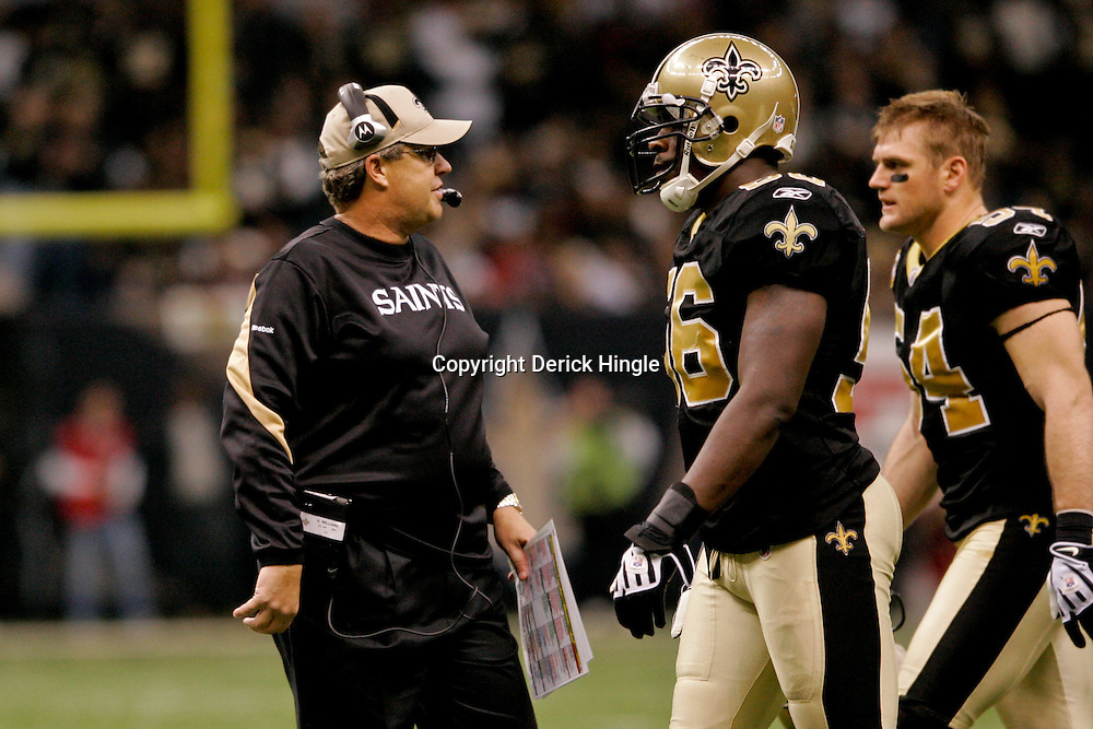 2009 November 30: New Orleans Saints defensive coordinator Gregg Williams talks to linebacker Jo-Lonn Dunbar (56) and linebacker Troy Evans (54) as they come off the field during a 38-17 win by the New Orleans Saints over the New England Patriots at the Louisiana Superdome in New Orleans, Louisiana.
