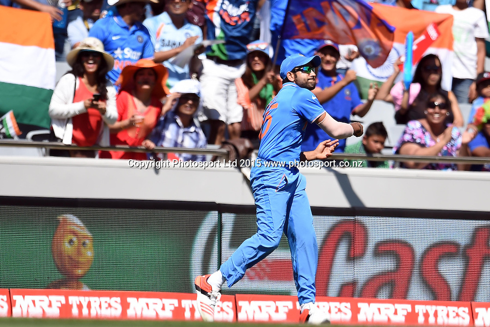 Indian fielder Rohit Sharma in action during the ICC Cricket World Cup match between India and Zimbabwe at Eden Park in Auckland, New Zealand. Saturday 14 March 2015. Copyright Photo: Raghavan Venugopal / www.photosport.co.nz