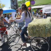 Cyclovia riders taking a break at one of several activity centers along the course