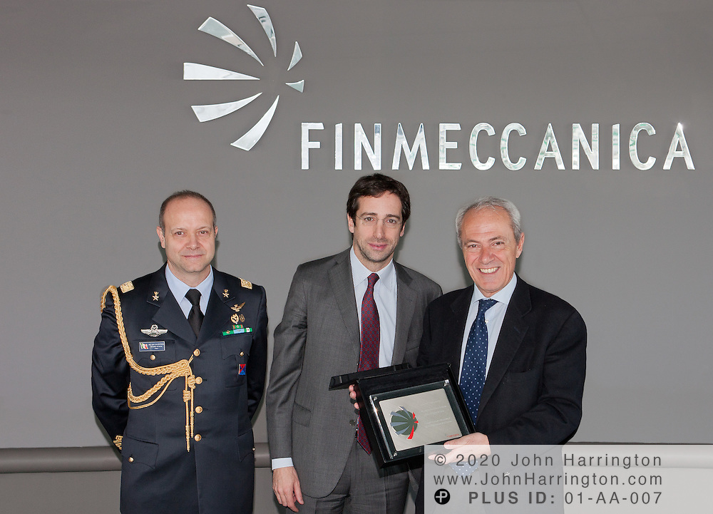 Finmeccanica CEO Simone Bemporad awards the Italian Undersecretary of State for Defense, Dr. Filippo Milone, with a plaque commemorating his official visit to the Finmeccanica North America offices in Washington, DC as Major General Gabriele Salvestroni,the Italian Defense and Defense Cooperation Attache at the Embassy of Italy, looks on on March 1st, 2012.