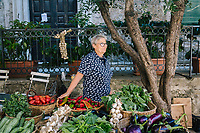 ACCIAROLI, ITALY - 14 SEPTEMBER 2018: Chiara Di Martino (64) poses for a portrait by the homgrown fresh fruit and vegetables she sells in Acciaroli, a small fishing village in the municipality of Pollica, Italy, on September 14th 2018.<br /> <br /> To understand how people can live longer throughout the world, researchers at University of California, San Diego School of Medicine have teamed up with colleagues at University of Rome La Sapienza to study a group of 300 citizens, all over 100 years old, living in Acciaroli (Pollica), a remote Italian village nestled between the ocean and mountains in Cilento, southern Italy.<br /> <br /> About 1-in-60 of the area's inhabitants are older than 90, according to the researchers. Such a concentration rivals that of other so-called blue zones, like Sardinia and Okinawa, which have unusually large percentages of very old people. In the 2010 census, about 1-in-163 Americans were 90 or older.