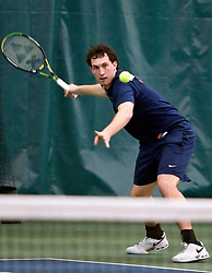 Virginia's Houston Barrick hits a forehand in #1 doubles against VT.  The #1 ranked Virginia Cavaliers faced the #31 ranked Virginia Tech Hokies in NCAA Men's Tennis at the Boar's Head Sports Club in Charlottesville, VA on February 27, 2009.