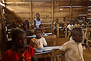 A girl stands up to give an answer during class at the Podio primary school in the village of Podio, Bas-Sassandra region, Cote d'Ivoire on Friday March 2, 2012.