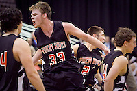 JEROME A. POLLOS/Press..Priest River's Jordan Willig races toward the bench as he celebrates the Spartans 79-65 win over the Salmon Savages in the championship game at the state 3A boys basketball tournament.