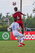 Portugal forward Jaoa Faria (5) heads the ball while Team USA forward Christian Torres prepares to pressure the ball during a CONCACAF boys under-15 championship soccer game, Saturday, August 10, 2019, in Bradenton, Fla. Portugal defeated Team USA 3-0 and advanced to the finals against Slovenia. (Kim Hukari/Image of Sport)