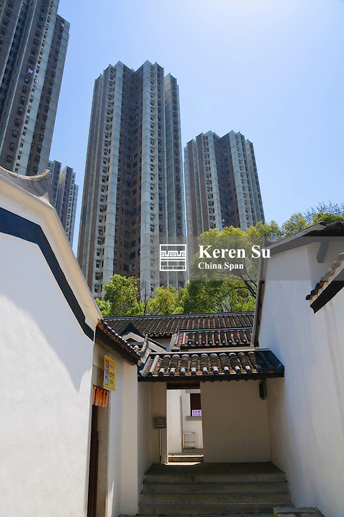 Traditional Kejia People's house with modern highrises, Hong Kong, China