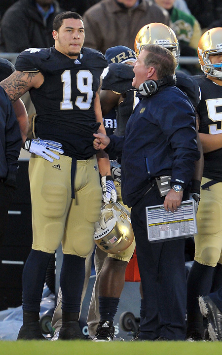 Head coach Brian Kelly, defensive end Aaron Lynch (19).