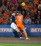 August 9th 2017, Dens Park, Dundee, Scotland; Scottish League Cup Second Round; Dundee versus Dundee United; Dundee's Kerr Waddell heads clear with Dundee United's Stewart Murdoch challenging