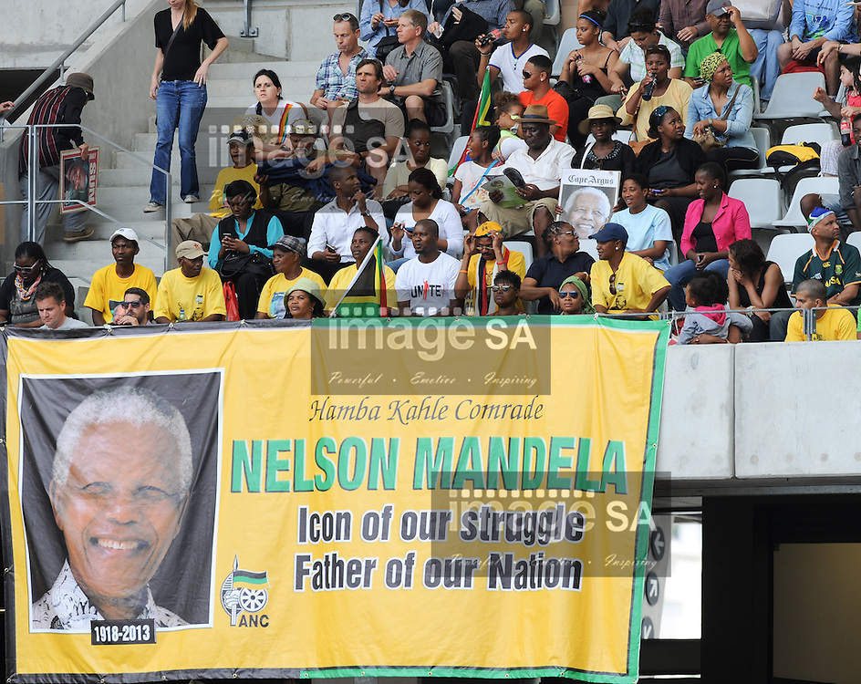 "Members of the crowd sing the South African national anthem during the City of Cape Town hosted concert at the 45000 seater Cape Town Stadium called ""Nelson Mandela - A life Celebrated"". Nelson Mandela was the first democratically elected president of South Africa."