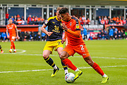 Luton Town defender James Justin (2) goes past Oxford United defender Sam Long (23) during the EFL Sky Bet League 1 match between Luton Town and Oxford United at Kenilworth Road, Luton, England on 4 May 2019.
