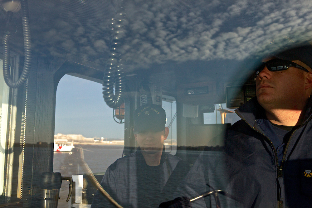 Executive Petty Officer Jeff Ritter, right, and a crew with the U.S. Coast Guard patrols the Potomac River as a part of security measures taken for the Presidential Inauguration ceremonies in Washington, D.C., on January 21, 2013.