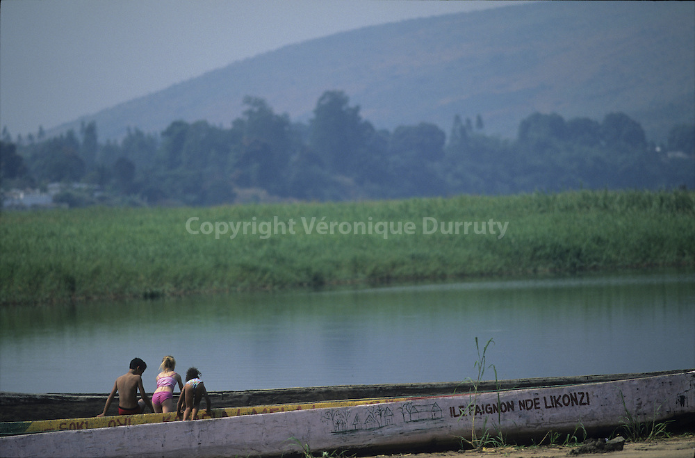 CHILDREN PLAYING NEAR THE RIVER. FAIGNON ISLAND, CONGO