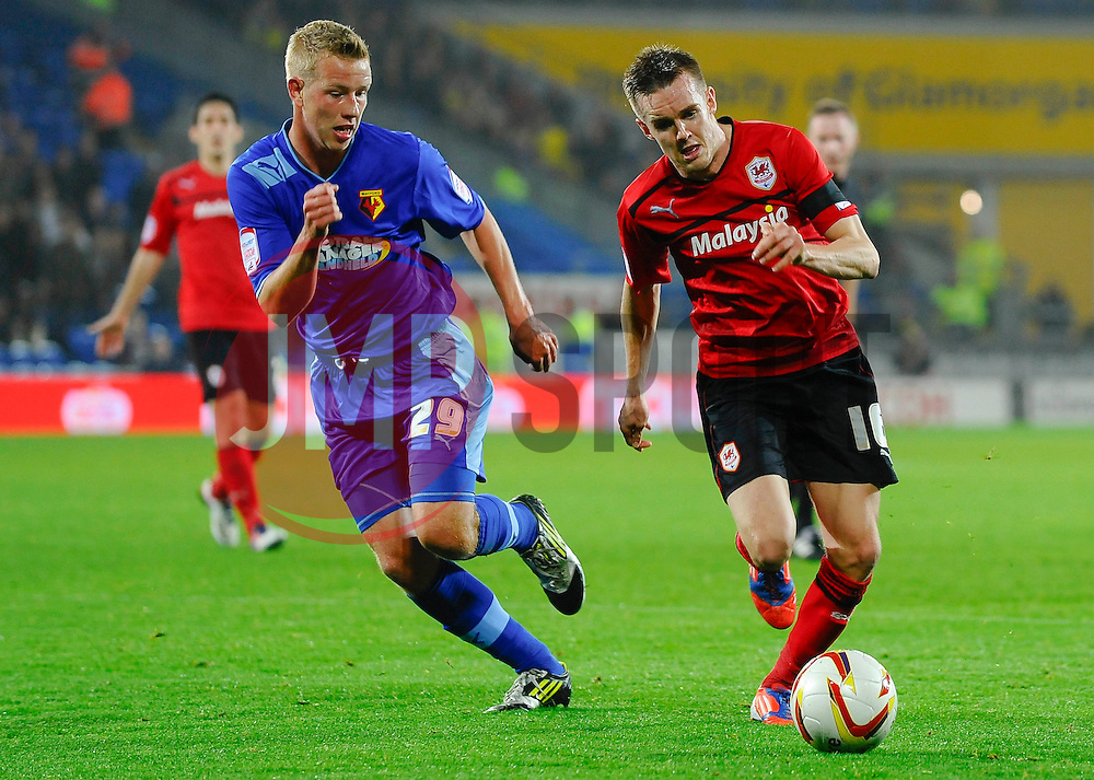 Watford Defender Adam Thompson (NIR) and Cardiff Midfielder Craig Noone (ENG) vie during the second half of the match - Photo mandatory by-line: Rogan Thomson/JMP - Tel: Mobile: 07966 386802 23/10/2012 - SPORT - FOOTBALL - Cardiff City Stadium - Cardiff. Cardiff City v Watford - Football League Championship