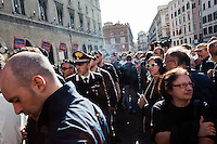 ROME, ITALY - 21 APRIL 2013: Carabinieri (Italy's armed forces) control supporters of the Five-Star Movement who gathered in Piazza Santi Apostoli and are now ready to march towards the Colosseum the day after the re-election of President Giorgio Napolitano,  in Rome, Italy, on April 21, 2013.<br /> <br /> Italy's lawmakers re-elected 87-year-old President Giorgio Napolitano on Saturday in a bid to break the country's political gridlock, as protestors outside parliament protested agains the result. Giorgio Napolitano won with a  majority of 738 ballots out of 1,007 possible votes, ahead of leftist academic Stefano Rodota, backed by the the anti-establishment Five Star Movement, who scored 217.
