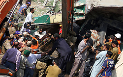 KARACHI, Nov. 3, 2016 (Xinhua) -- People work at the site of a collision between two trains in southern Pakistani port city of Karachi, Nov. 3, 2016. At least 21 people were killed and 45 others injured when two passenger trains collided with each other in Pakistan's southern port city of Karachi on Thursday morning, hospital officials said. (Xinhua/Arshad).****Authorized by ytfs* (Credit Image: © Arshad/Xinhua via ZUMA Wire)