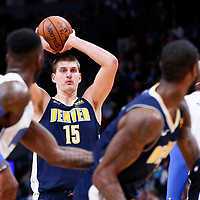 11 November 2017: Denver Nuggets center Nikola Jokic (15) passes the ball to Denver Nuggets guard Will Barton (5) during the Denver Nuggets 125-107 victory over the Orlando Magic, at the Pepsi Center, Denver, Colorado, USA.