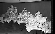 "07/02/1964<br /> 02/07/1964<br /> 07 February 1964<br /> Erin Foods Reception at the Sybaris Club, Abbey Street, Dublin. Image shows a display of ""Redichips"", Erin Soups, Instant Potato Flakes and peas."