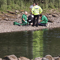 Tay River Accident...13.7.2005.<br /> Police assist paramedics as they try to revive the teenager on the banks of the Tay in Perth City Centre.<br /> (Please see Gordon Currie story 01738 446766).<br /> <br /> NO BYLINE TO BE USED WITH IMAGE.<br /> Picture by John Lindsay<br /> COPYRIGHT: Perthshire Picture Agency.<br /> Tel. 01738 623350 / 07775 852112.