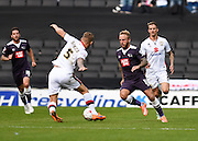 Derby County forward Johnny Russell and Milton Keynes Dons defender Kyle McFadzean during the Sky Bet Championship match between Milton Keynes Dons and Derby County at stadium:mk, Milton Keynes, England on 26 September 2015. Photo by David Charbit.
